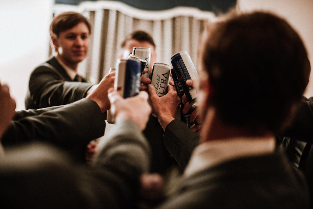 Groomsmen toasting before wedding