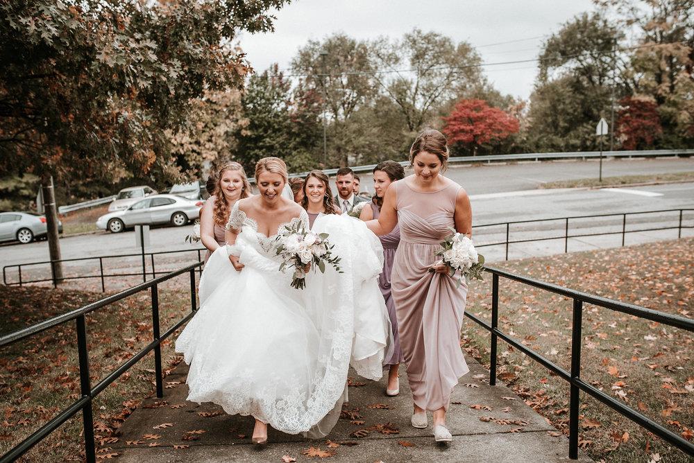 Bride and bridesmaids leaving wedding