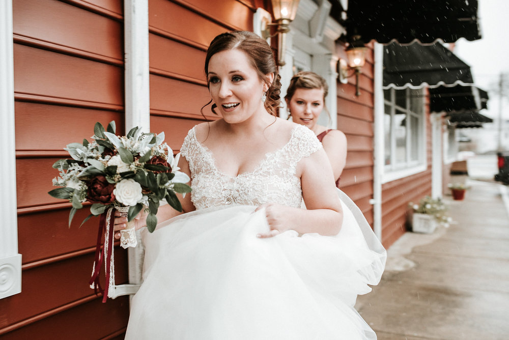 Bride walking under awnings