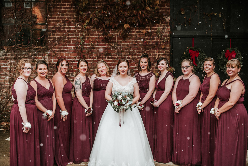 Bride and bridesmaids in snow