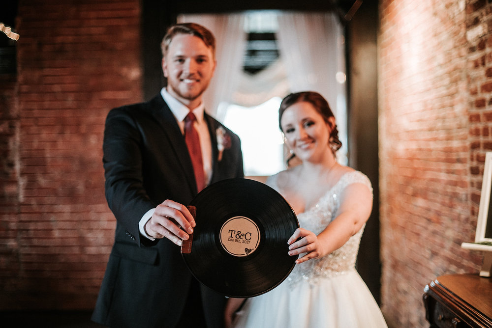 Bride and groom holding record