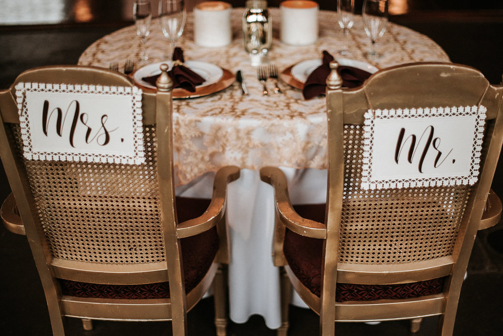 Mr and Mrs seats at reception