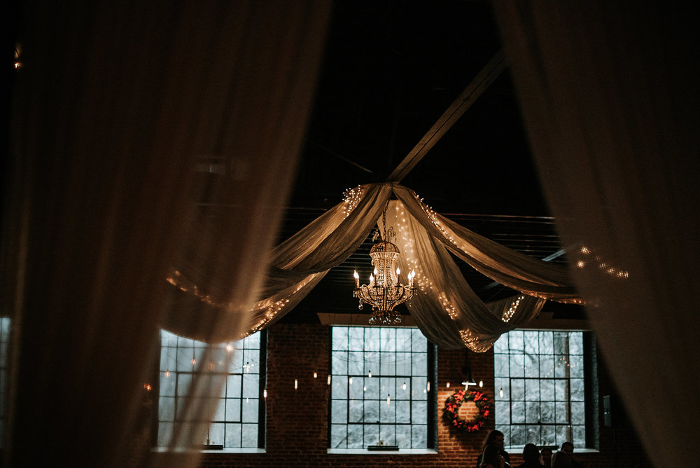 Chandelier and tulle in wedding venue