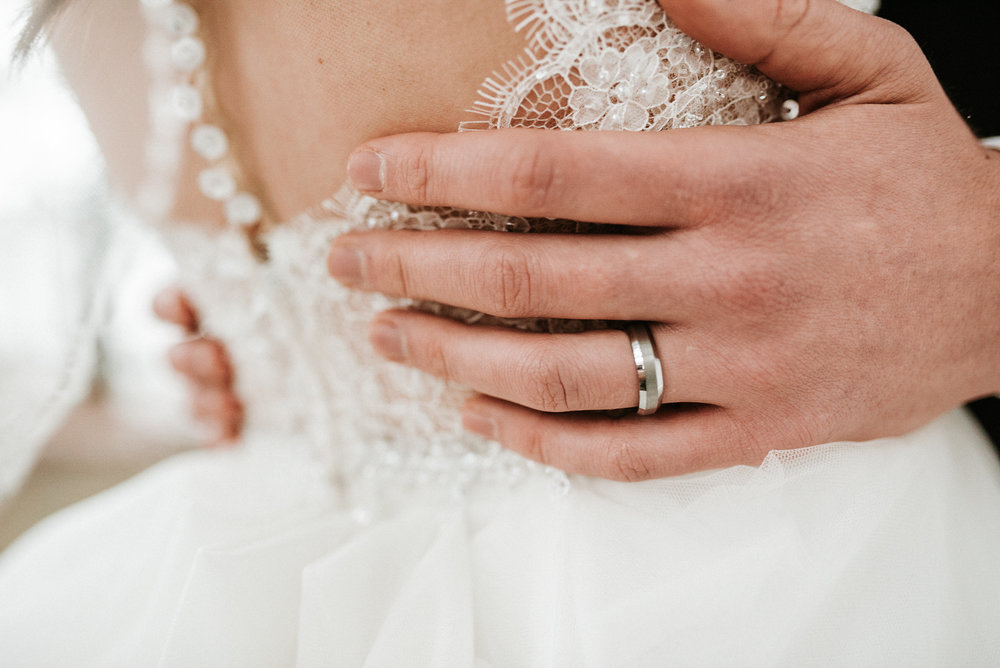 Groom's hands on bride's waist