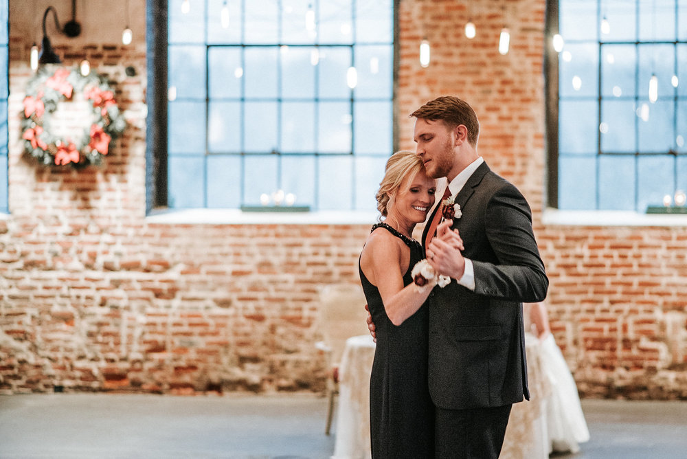 Groom and sister dance