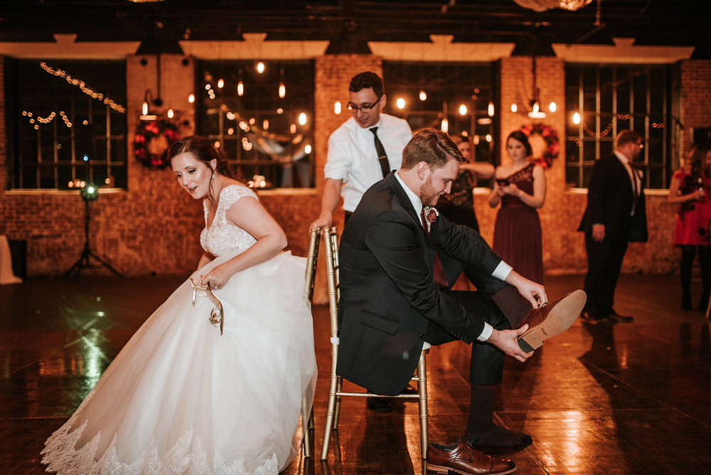 Bride and groom exchanging shoes