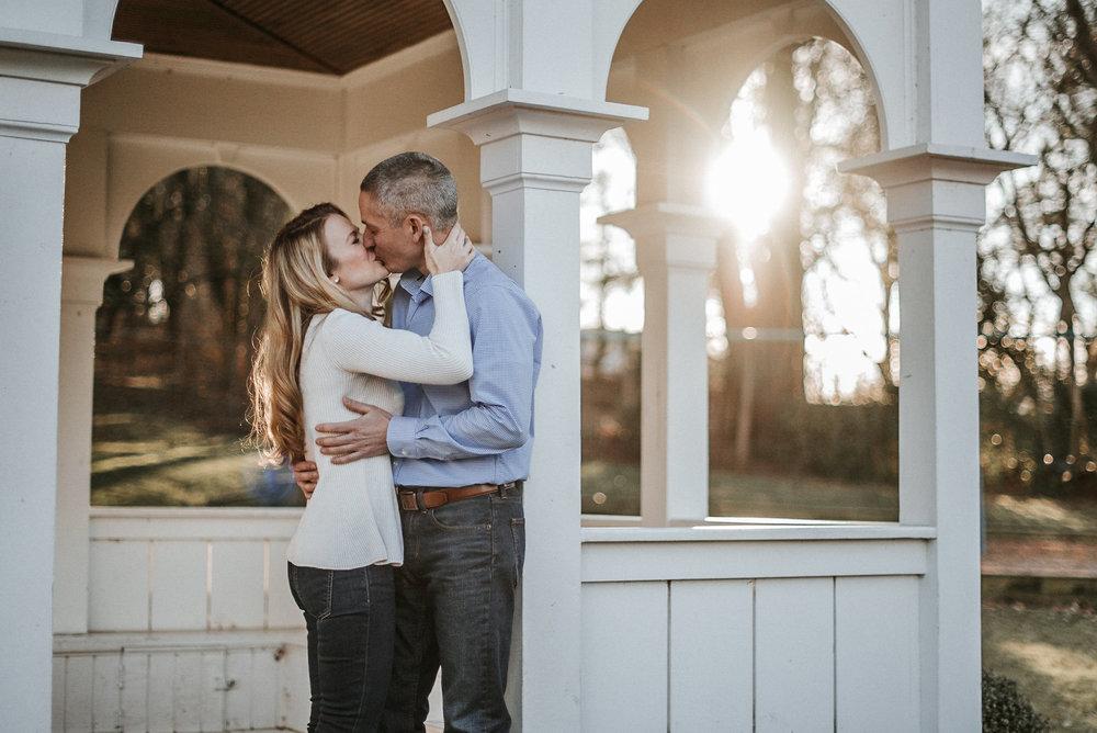 Couple kissing in gazebo