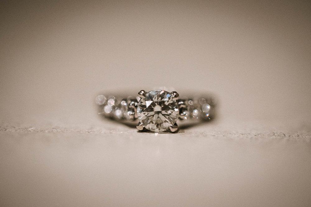 Diamond wedding ring on ground