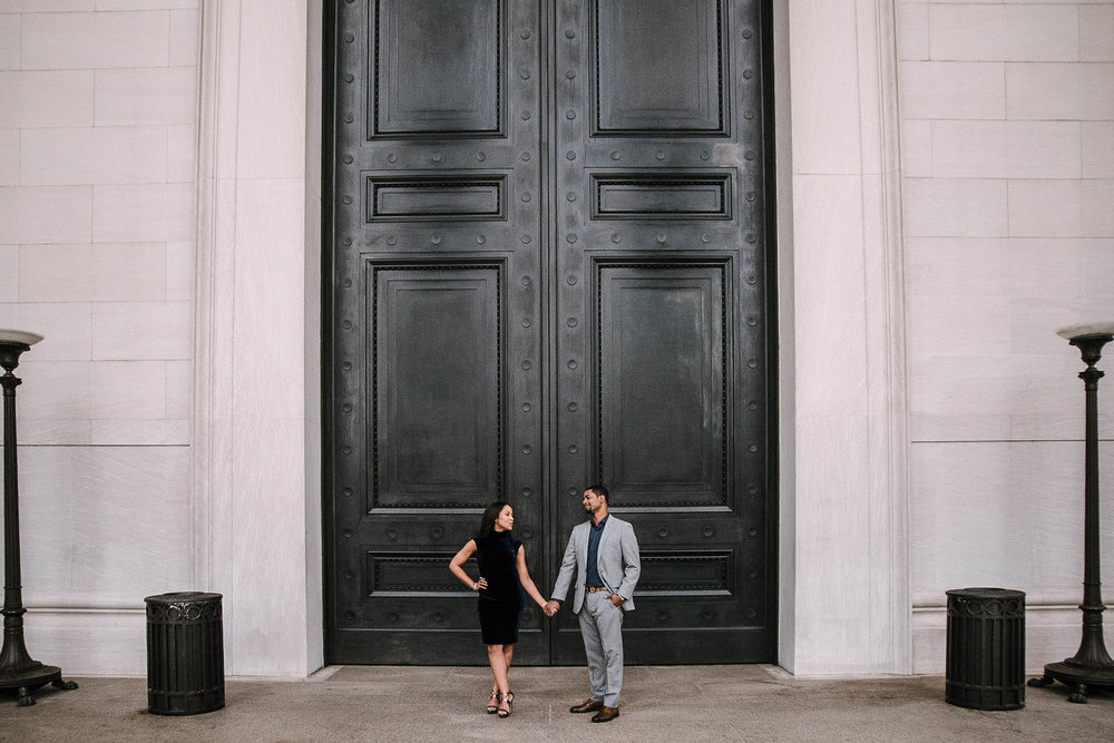 Couple standing in front of large doors