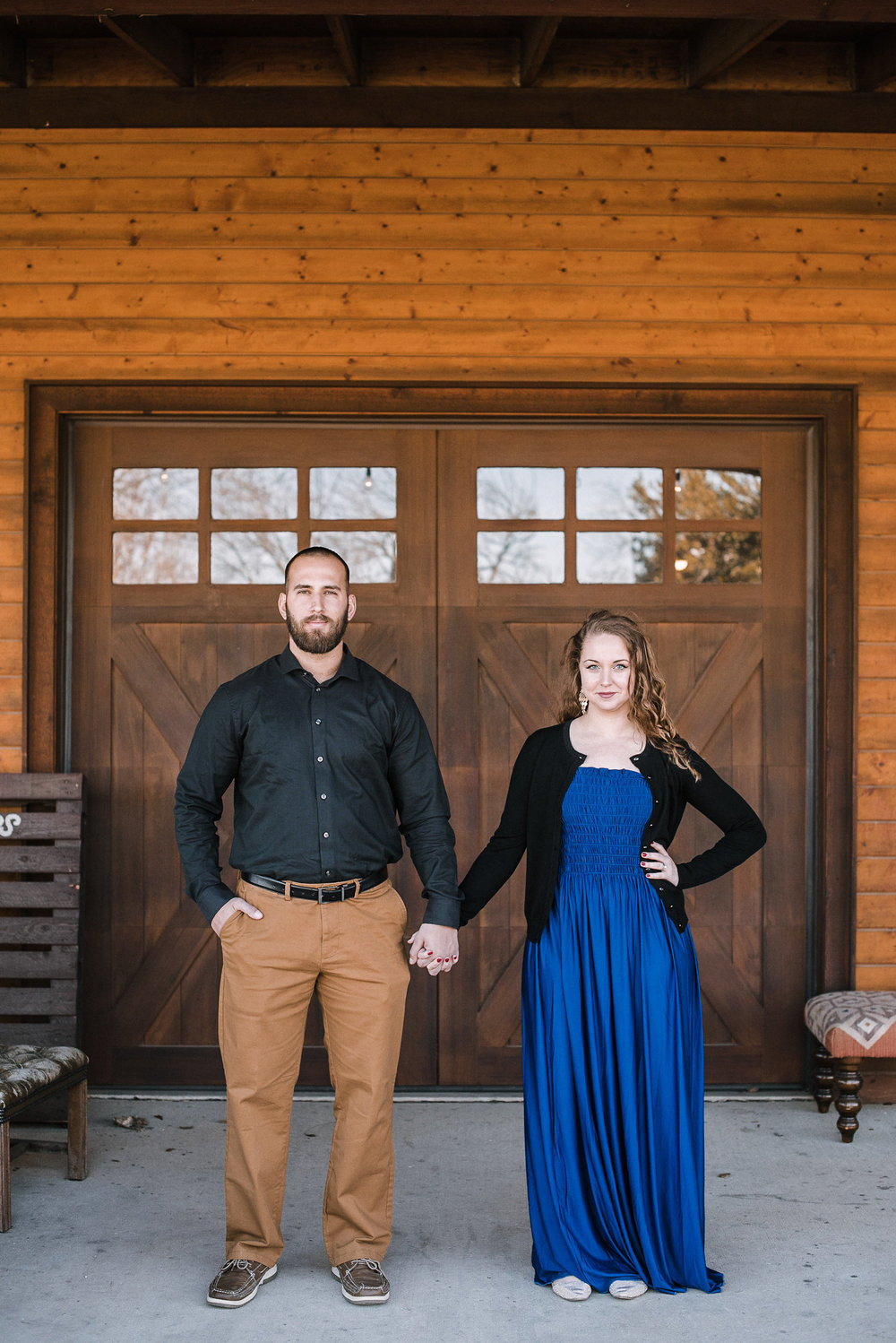 Couple standing on barn porch