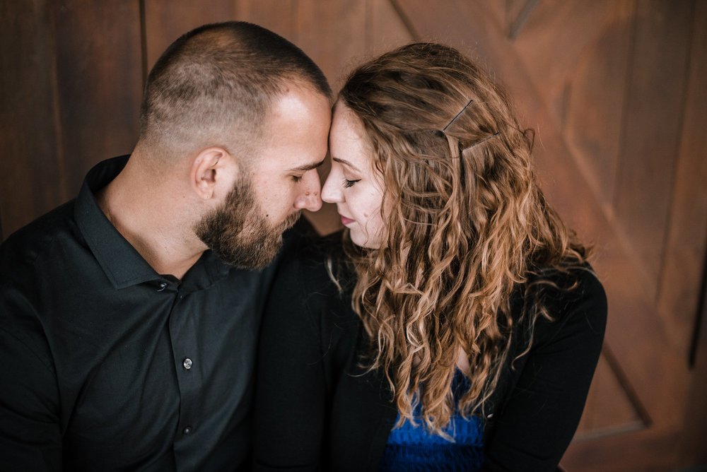 Man and woman touching foreheads