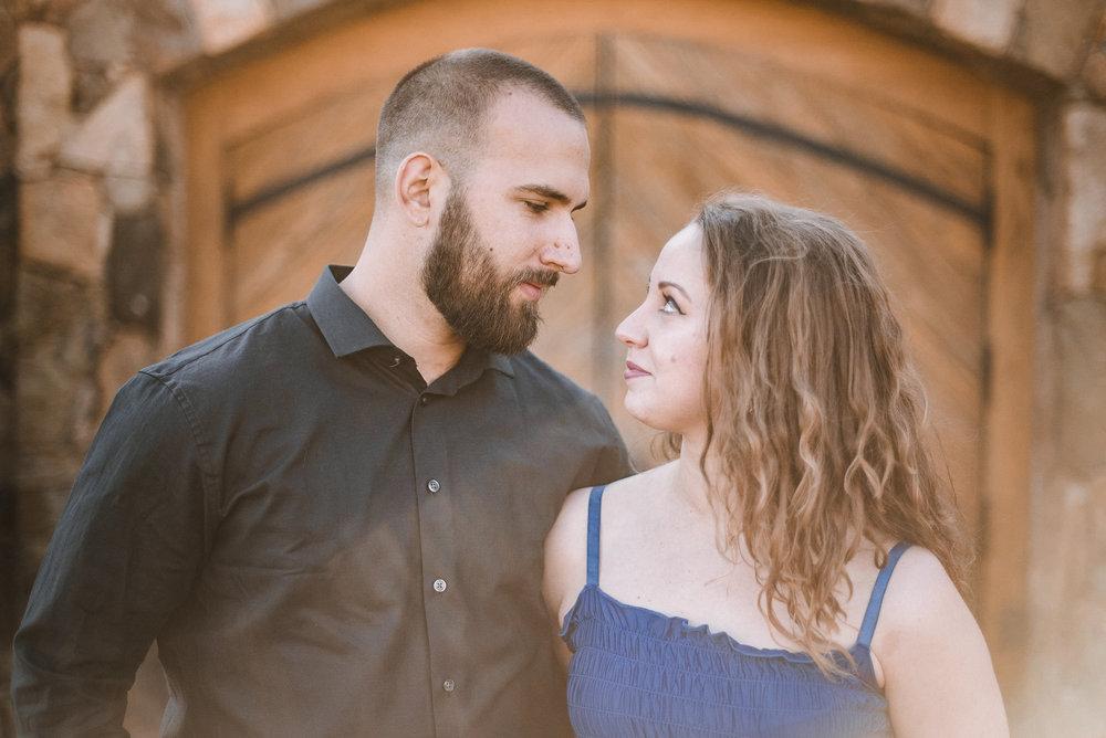Couple standing in front of doors