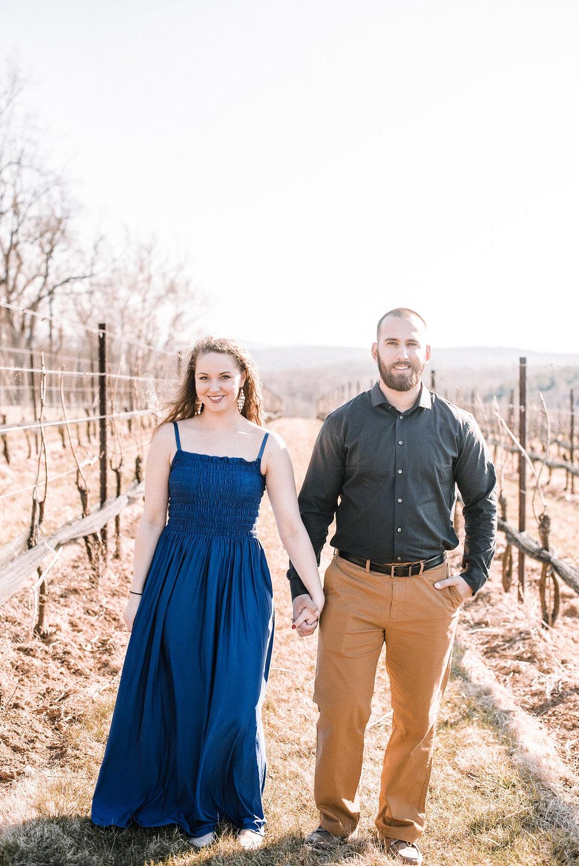 Couple standing in vineyard