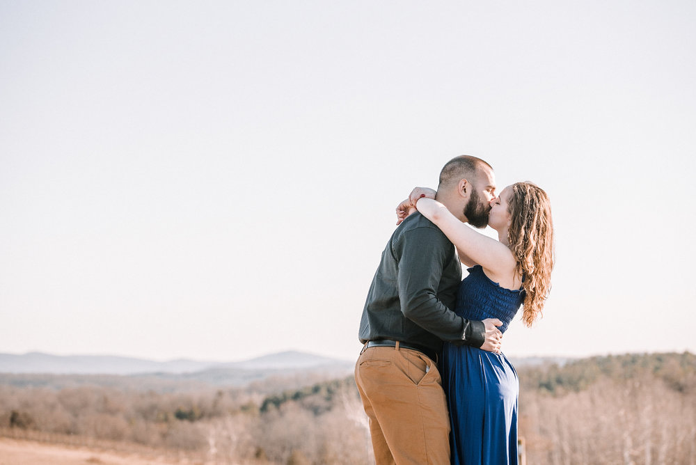 Couple kissing in front of mountains
