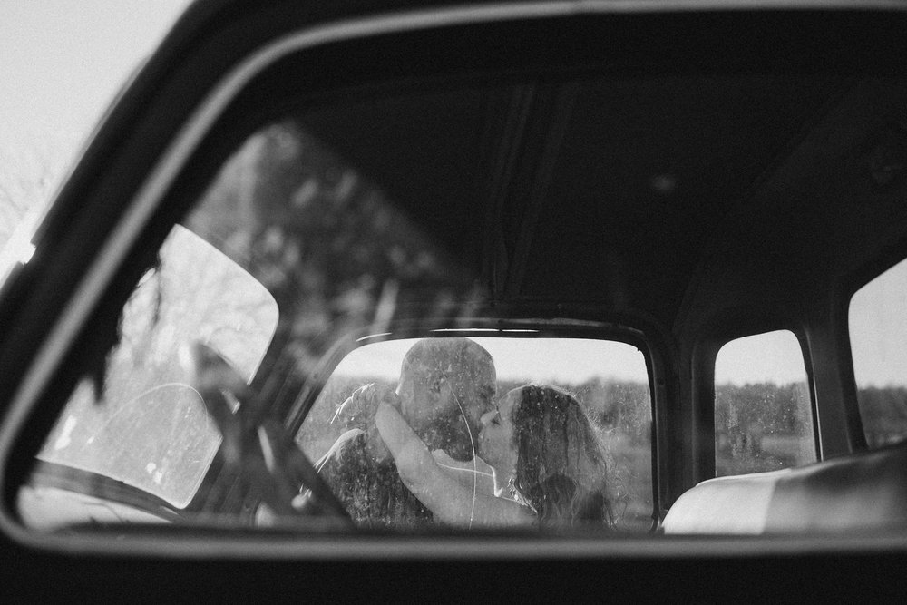 Couple seen kissing through car window