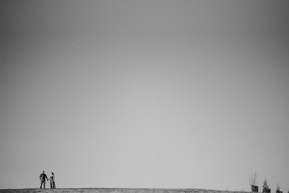 Couple in distance in black and white