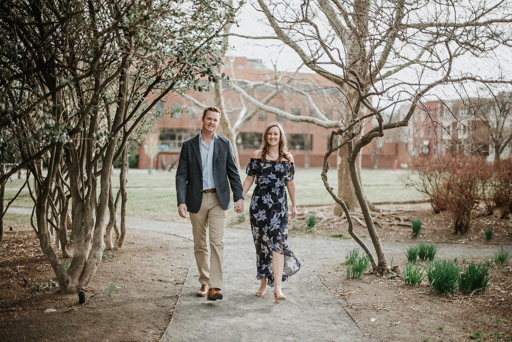 Man and woman walking through park