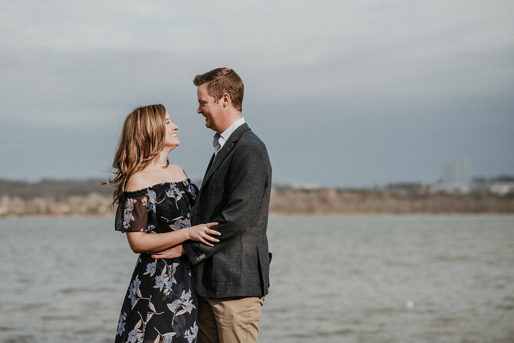 Couple standing in front of waterfront