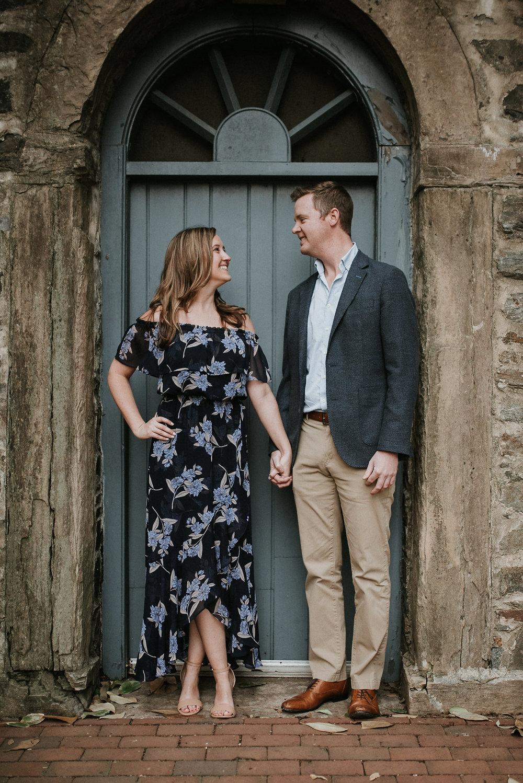 Couple holding hands in doorway