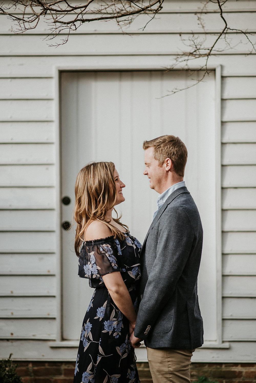 Couple in front of white door