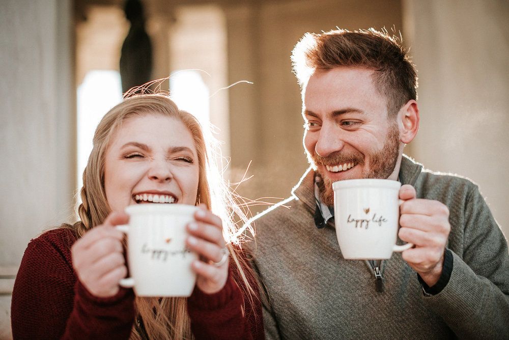 Couple laughing with mugs