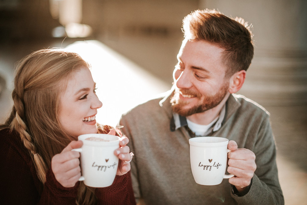 Couple smiling with mugs