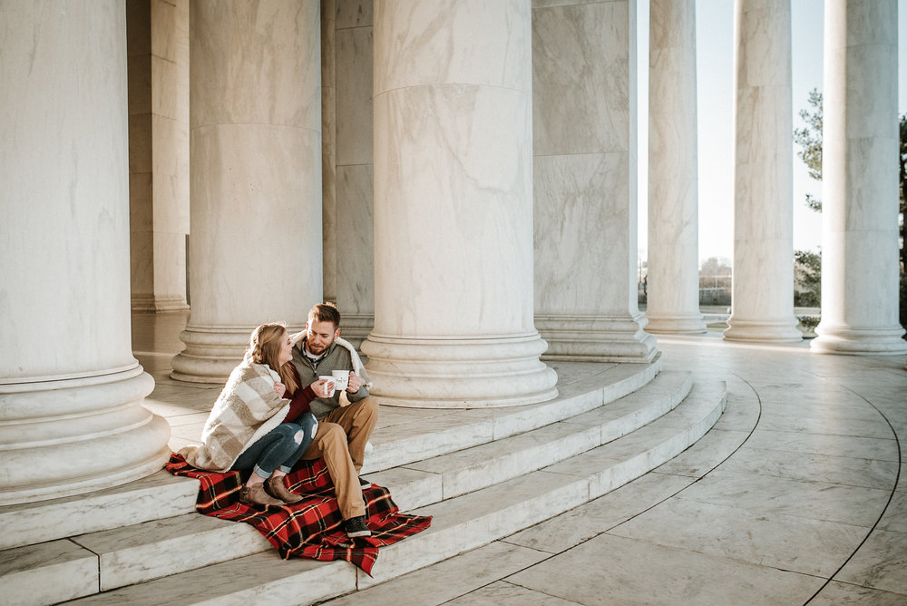 Couple sitting at Jefferson Memorial