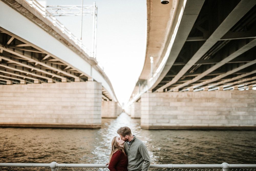 Couple kissing under bridge
