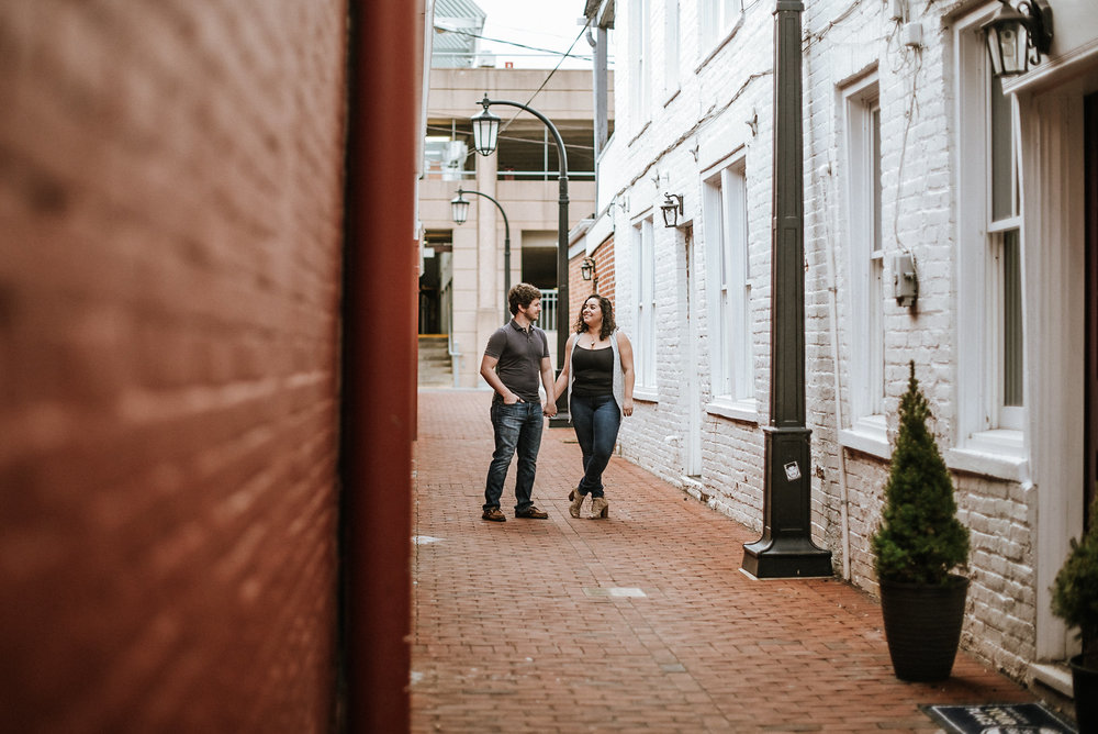Couple walking down historic alley