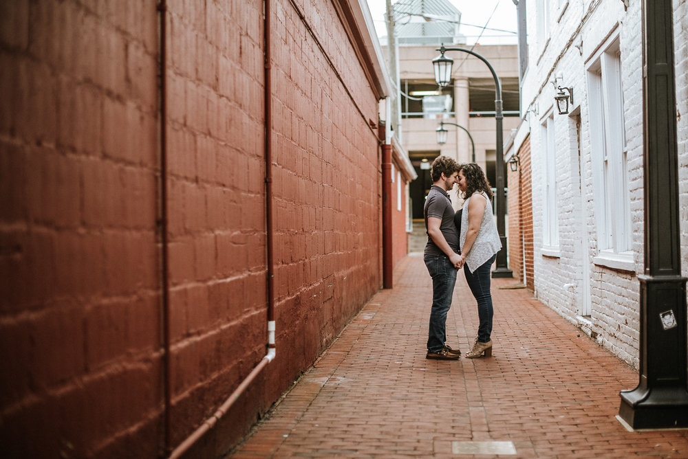 Couple kissing in alley