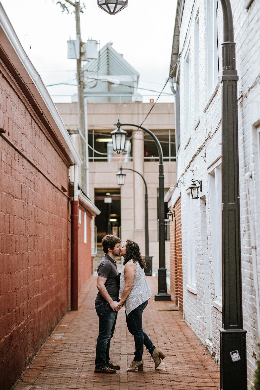 Couple kissing under lantern