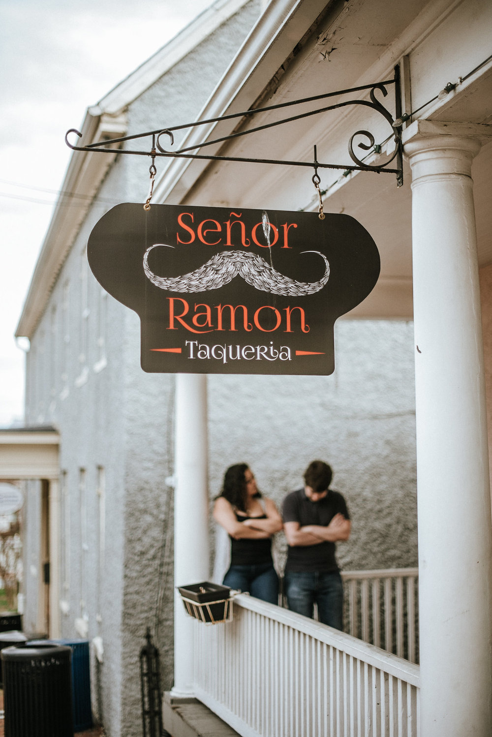 Couple standing on restaurant porch