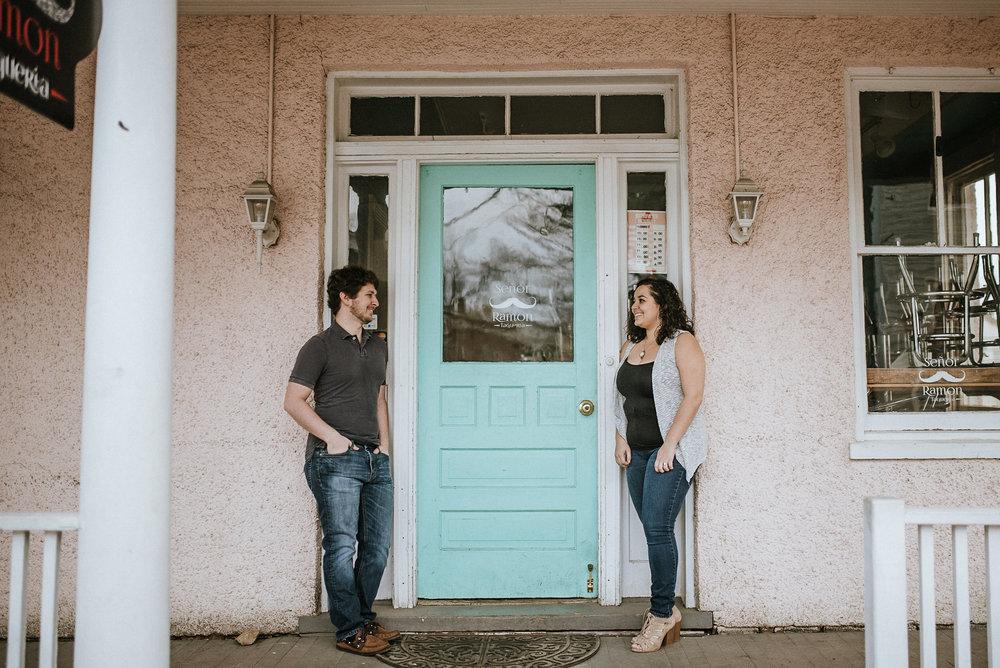 Couple standing by blue door