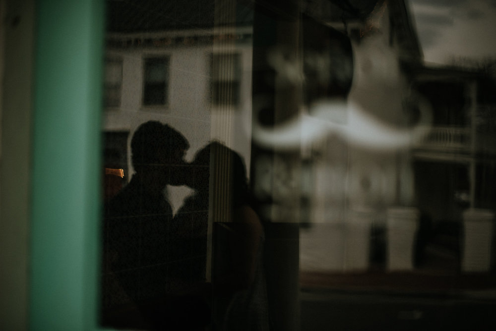 Reflection of couple kissing in window