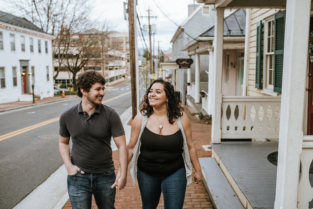 Couple walking on brick sidewalk