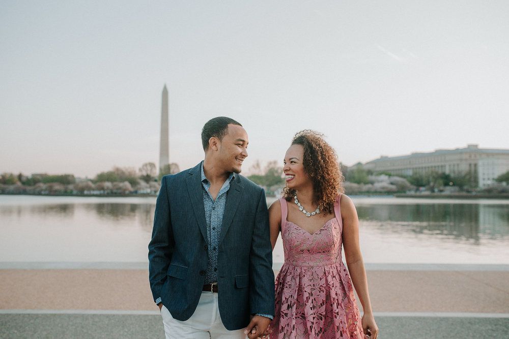Couple smiling at one another on National Mall