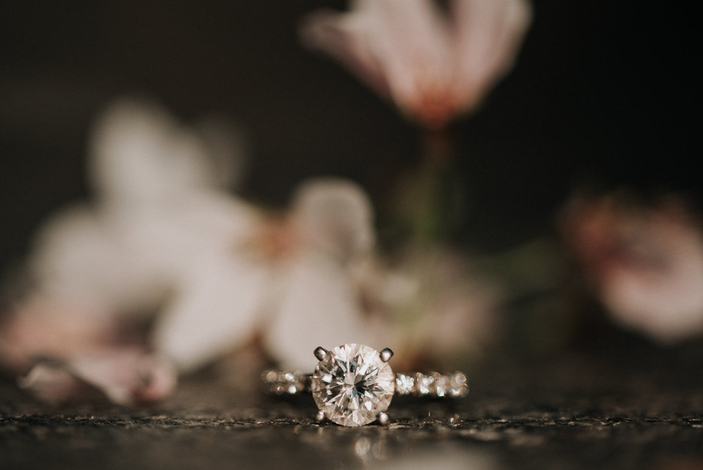 Wedding ring on stone bench