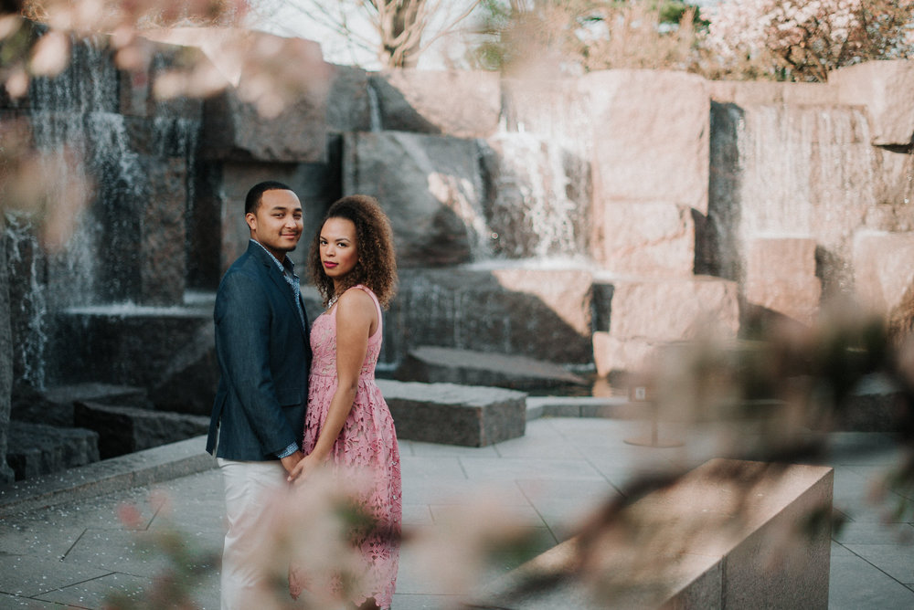 Couple standing among fountains