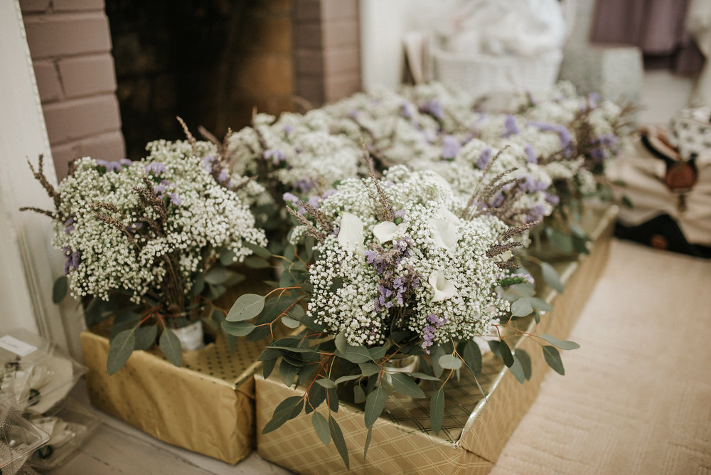 Boxes of bouquets at wedding