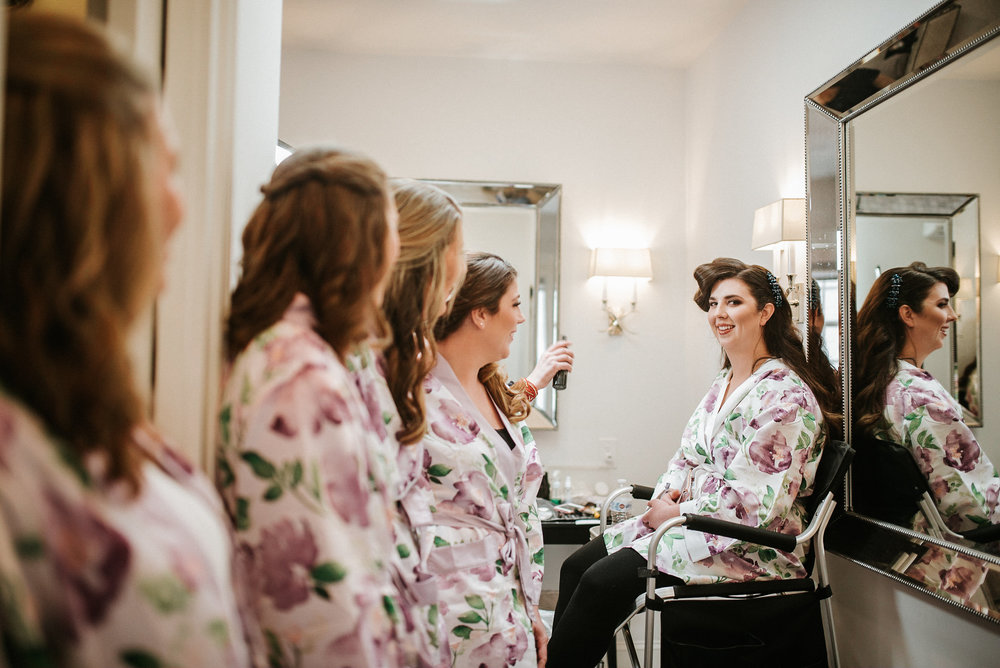 Bridesmaids and bride getting ready for wedding