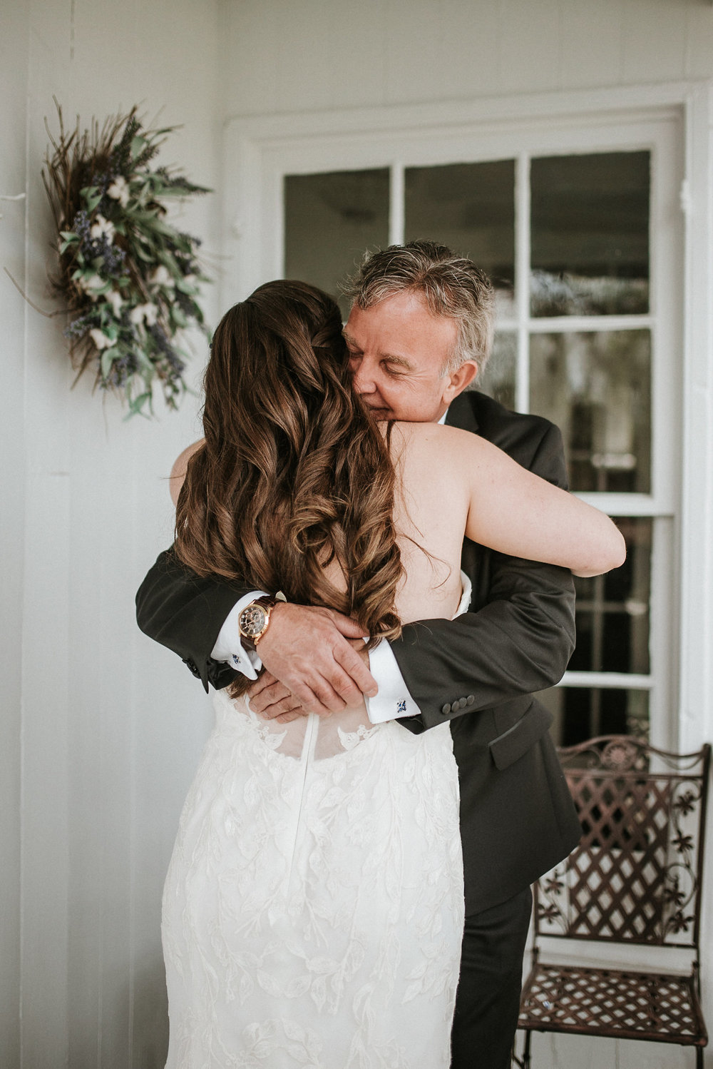 Father and bride hugging before wedding