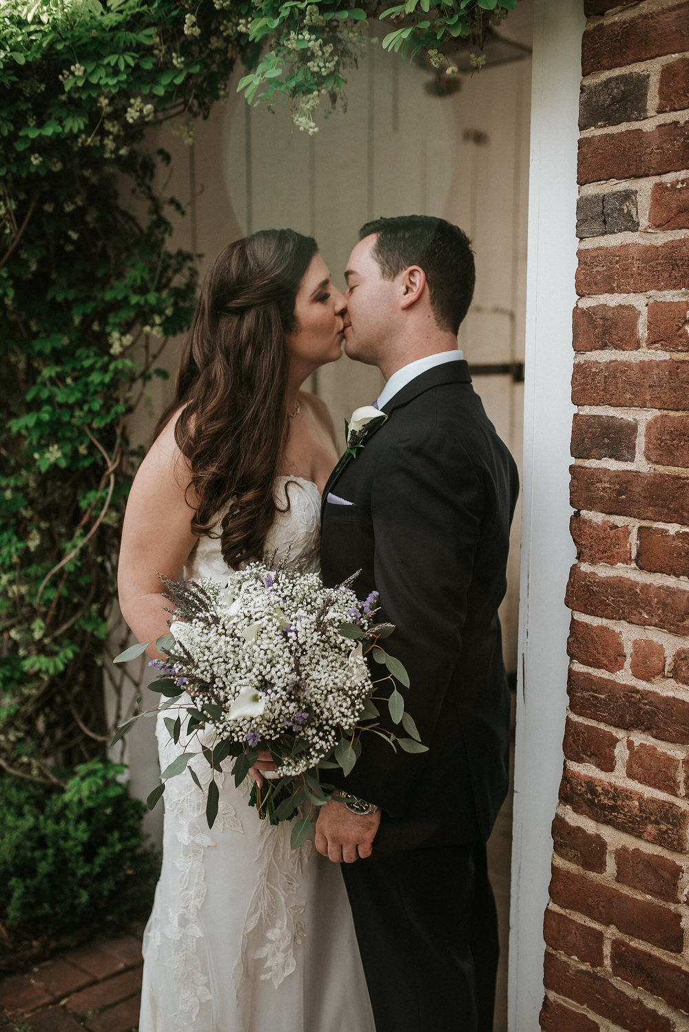 Bride and groom kissing before wedding