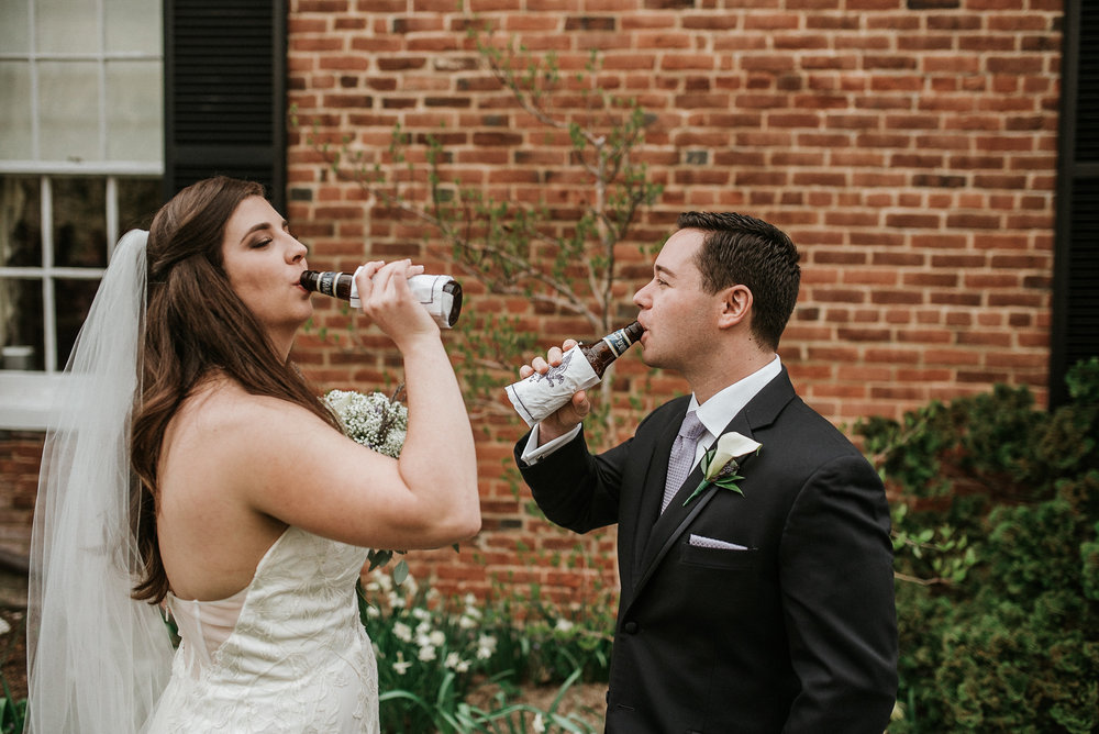 Bride and groom drinking a beer