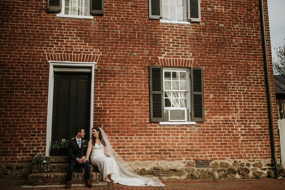 Bride and groom sitting on stoop