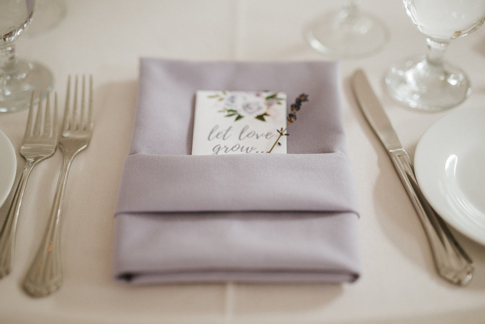 Lilac table setting at wedding reception