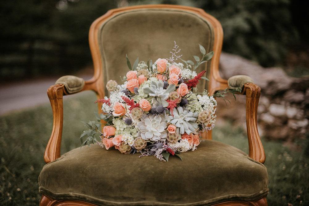 vintage chair with succulent bouquet photo
