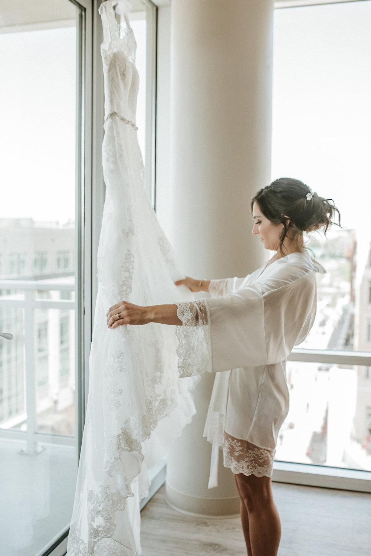Bride looking at bridal dress