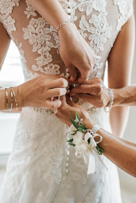 Fastening back of wedding dress