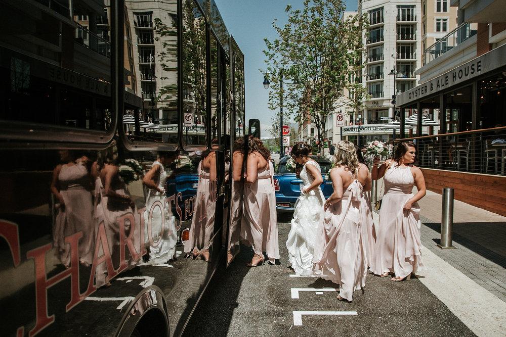 Bride and bridesmaids boarding party bus