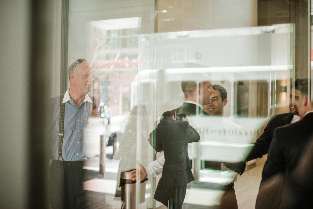 Groomsmen in hotel lobby
